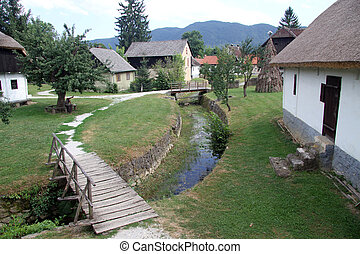 Wooden bridge - Bridge on the river and house in Kumrovets,...