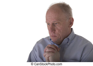Older Man in Grief - An older man praying with an expression...