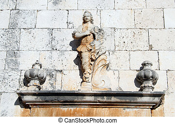 Stone sculpture on the wall of church in Supetar, Brach...