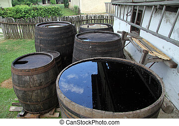 Barrels with water - Wooden barrels with water near house in...