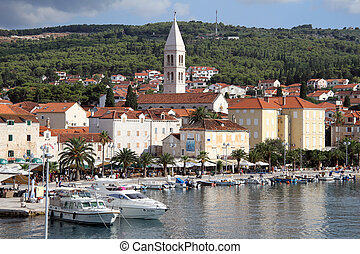 Supetar and boats - Church and buildings in the Supetar,...
