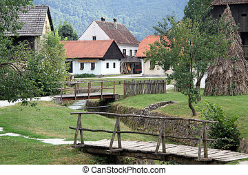 Wooden bridges and houses in village Kumrovets in Croatia