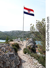Flag on hill - Flag on the top of hill in Skradin, Croatia