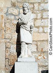 Statue of saint near church in Supetar, Brach island,...