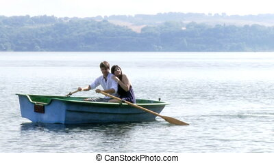 beautiful woman and man on a lake