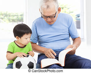 grandfather reading a story book for his grandson