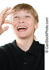 Portrait of a smiling teenager is isolated on a white background.
