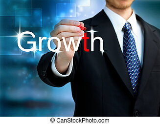 Young business man writing the word Growth with red pen