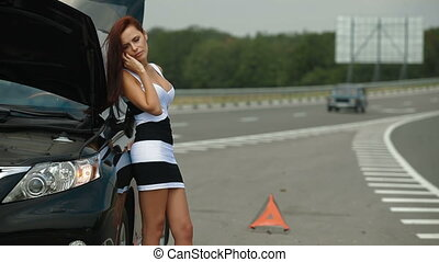 Road Help - Woman having car troubles on the road, calling...