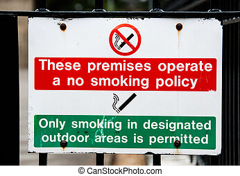 No smoking on premises sign, only smoke in designated areas...