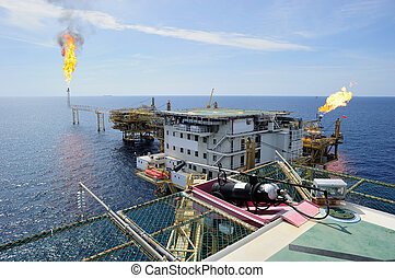 Offshore gas platform - An offshore gas platform burning gas...
