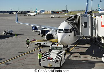 Airplane with Loading Dock Attached - An airplane sitting on...