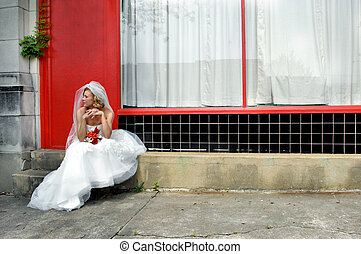 Alley Beauty - Bride sits on steps of downtown alley. Bright...