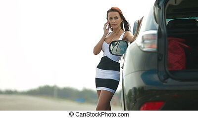 Woman with her Broken Car - Woman having car troubles on the...