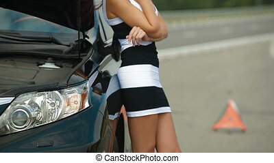 Calling Emergency Repair Service - Woman having car troubles...