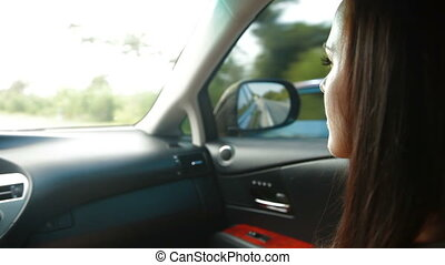 Young Woman Inside Car