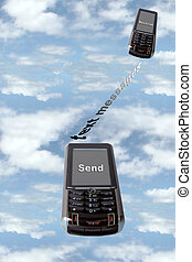 text messaging - two cellphones against a coudy sky...