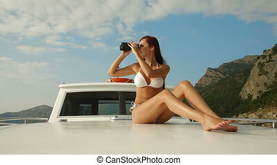Bikini Beauty With Binoculars