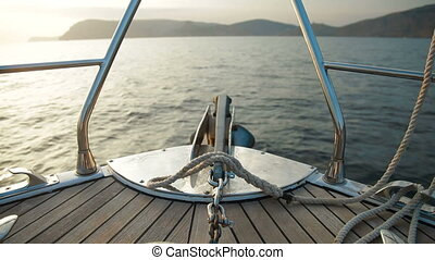 Bow of Sailing Yacht - Sailing yacht cruising the...