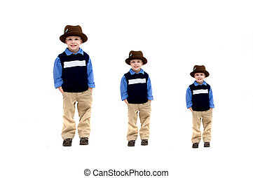 Growth Spurt - Little boy wearing a hat and khakis is...