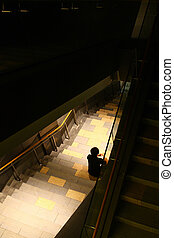 One person sits in the stairs - A person sitting on the...