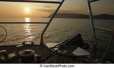 Bow of Sailing Yacht at Sunset