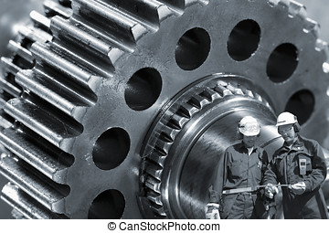 industry workers and gear machinery - two industrial workers...