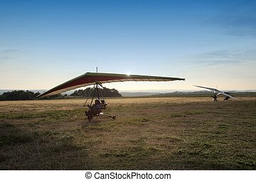 The motor hang-glider on the runway at sunset