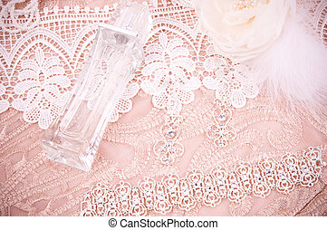 Beautiful bottle of perfume and lace