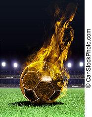 fiery soccer ball on field - fiery soccer ball on playing...