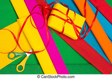 Gift wrapping - Wrapping paper, scissors and gift box with...