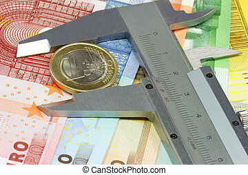 Caliber with one euro and euro banknotes in the background