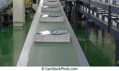 printing - assembled books moving around the assembly line
