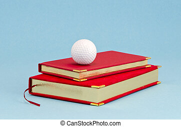 gilded business diary and golf ball - gilded red business...