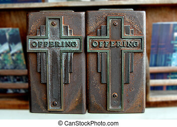 Alms and Offerings - Two heavy metal boxes sit in the entry...