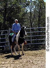 Cowboy Horsey - Rider smiles with enjoyment as his paint,...