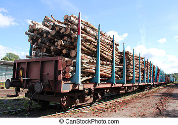 Transporting Wood on a Train - Rail cars of wood at the...
