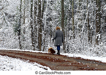 Ambling in the quiet woods - Woman and her pomeranian ambles...