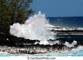 Big Bang - Large wave hits the rocky shores of the Big...