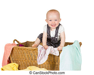 Laughing baby playing in a laundry basket - Laughing baby...
