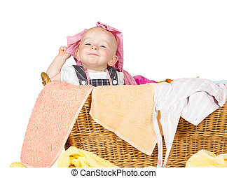 Impish little baby in the laundry