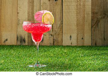 Strawberry Watermelon Daiquiri decorated in front of a...