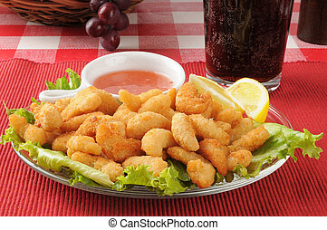 Popcorn shrimp with root beer - A plate of popcorn shrimp...