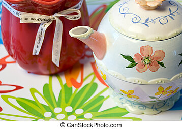 Close-up Mothers Day - Mothers Day candle and teapot on a...