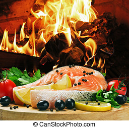 salmon steak with vegetables cooked on the grill