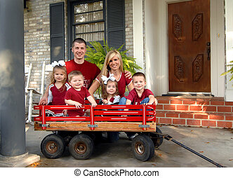 All About Family - Family of six smile for a family photo....