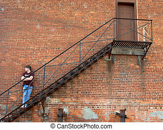 Alley Stairs - Black iron fire escape serves as resting...