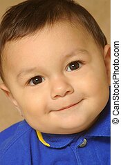 Handsome smiling toddler boy - Closeup tight portrait of a...