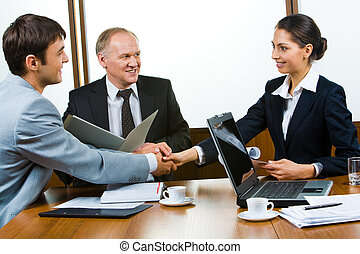 Business consensus - Photo of business partners holding...