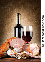 Wine and meat on an old canvas